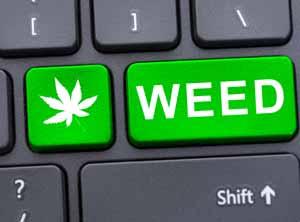 Drug concept with weed text on keypad with marijuana leaf symbol