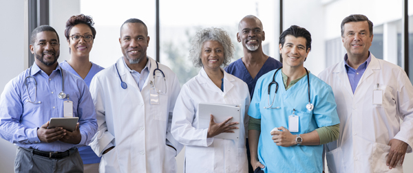 Group of medical professionals smile together for a photo