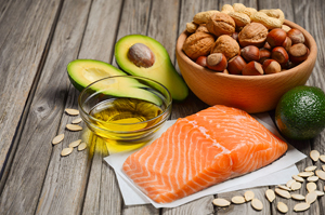 Selection of healthy fat sources, rustic background, selective focus, copy space