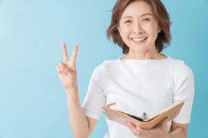 Asian senior age woman who fills out a schedule book